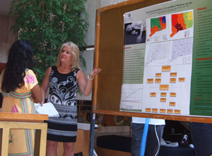 Photo of Cheryl Marenick speaking to a biomedical science student