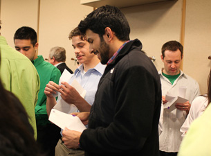 Fourth-year medical students opening their envelopes to find out what residency program they've been accepted into during Match Day 2011.