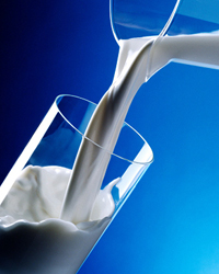 Photo of milk being poured into a glass