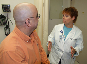 Photo of Arlene Morin seeing a patient