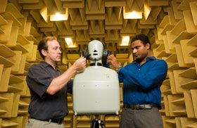 Donald Peterson, left, an assistant professor of medicine, and Subhash Gullapalli, a research engineer, working in an anechoic chamber at the Health Center.